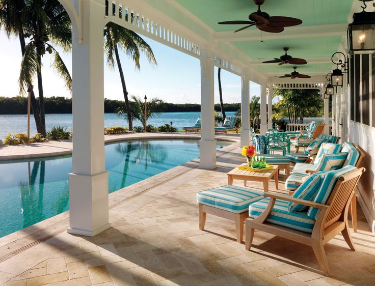 Sleek White Walls, Stunning Wood Flooring And Accent Colors To Reflect The Water Give This Islamorada Home The Feel Of An Old Florida Beach House