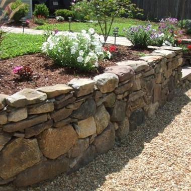 Ranch style homes often feature a veneer of stone on the bottom third of the. 25  best ideas about Rock wall landscape on Pinterest   Terraced
