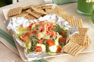Warm Italiano Spread   ( I make this ALL the time - YUM. )    8 oz cream cheese  1/4 cup pesto  1-2 chopped roma tomatoes  1/2 c shredded mozzerella     Bake 12-15 mins @ 375 till middle is soft & cheese melted.  Serve with Wheat Thins or Cracked Pepper Triscuits.  You can also wrap it in foil & put it on the grill!!