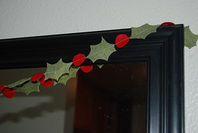 Holly Garland - I just drew my own holly leaf onto freezer paper and traced a quarter for the red berries. Then I sewed it in a chain. I love the simple, but classic touch it adds to the mirror in the entry way.  by Serena