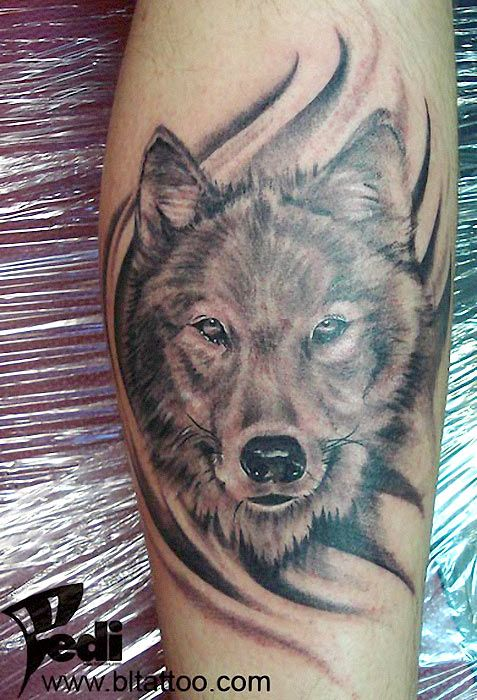 Wolf tattoo on arm (pinner says: I think I'll get this on my shoulder though)