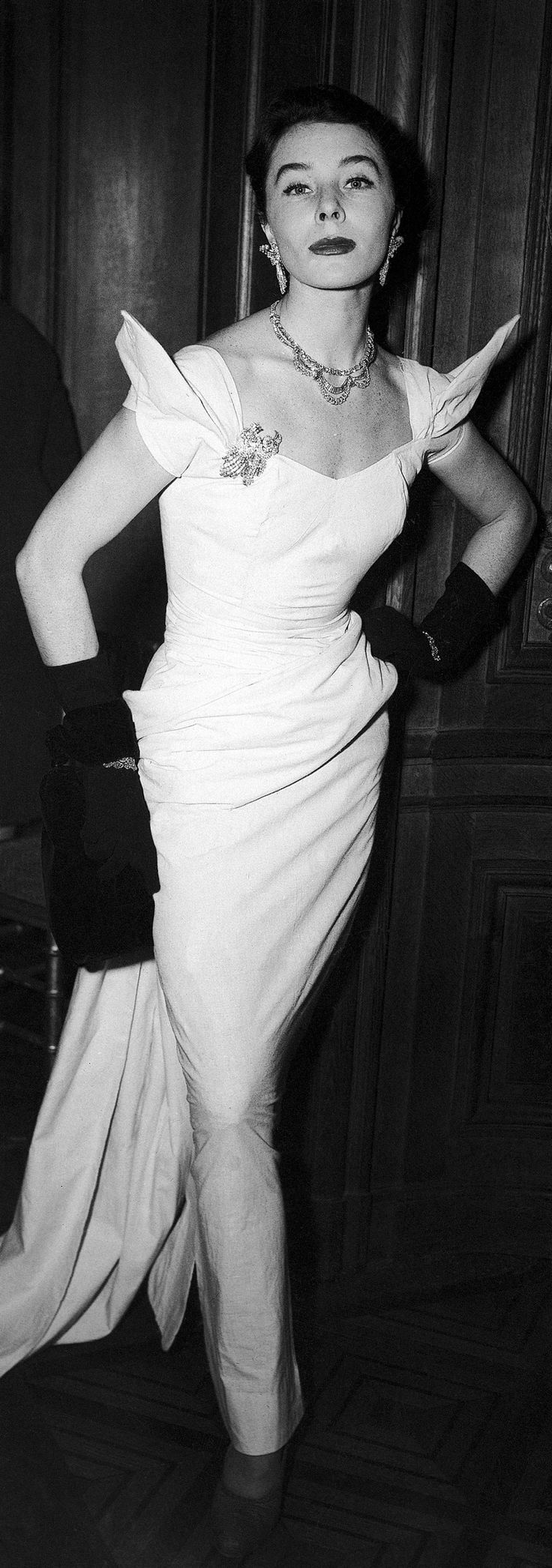 French model Simone Micheline Bodin, known as Bettina, models an evening dress including $35 million worth of jewelry on Nov. 5, 1952. The black evening bag was designed by Andre Dallioux.