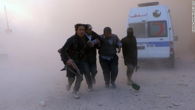 Caption:Fighters from the al-Qaida group in the Levant, Al-Nusra Front, help a wounded man following a reported barrel bomb attack by government forces in the Al-Muasalat area in the northern Syrian city of Aleppo on November 6, 2014. Syria has asked Russia to speed up delivery of S-300 anti-aircraft missiles, concerned about a possible US attack, Syrian Foreign Minister Walid Muallem said in an interview published Thursday. AFP PHOTO/AMC/FADI AL-HALABI (Photo credit should read Fadi ...