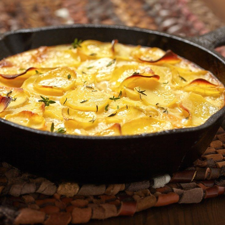 Old-Fashioned Scalloped Potatoes (added garlic and thyme while making the roux and only used 3 russet potatoes)