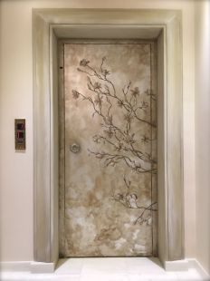 Painted magnolia flowers on a silver leaf background. Elevator doors in a house in Athens, Greece. Artist: Manuela Palinginis