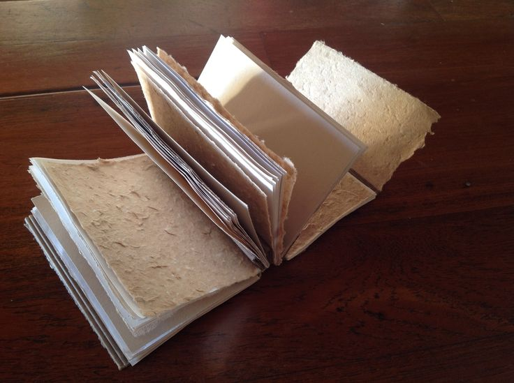 Handmade Paper alternating with ordinary jotter pages.