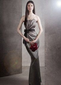 Draped satin long dress with black grosgrain sash and exposed zipper.   Asymmetrical draping and Art Deco details make this dress classically unique.  Black grosgrain sash is included for all colors.  Exposed zipper in back adds a fashion forward approach. Fully lined. Dry clean only. Distinguish your maid of honor by adding a different White by Vera Wang sash: horsehair, floral, or crystal. Another option is to choose the short version of this dress, VW360017, for the rest of your party…