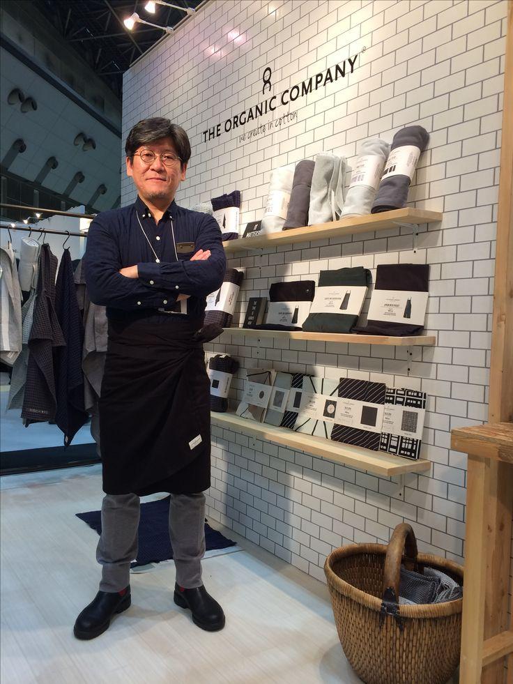 "Our distributor, Marcs International. IFFT fair, Tokyo. Wearing a ""towel to wrap"" #theorganiccompany"