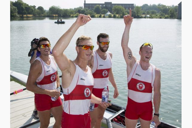 Canada's (left to right) Kai Langerfeld, Tim Schrijver, Conlin McCabe, and Will Crothers waves to fans after winning gold in the the men's coxless four final at the 2015 Pan Am Games at the Royal Canadian Henley Rowing Course in St.Catharines, Ont. on Monday, July 13, 2015. PETER POWER / THE CANADIAN PRESS
