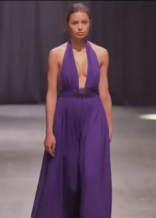 Violet dress with plunging neckline.