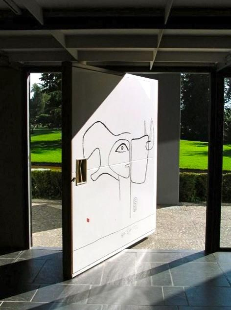 Le Corbusier often used pivot doors as a canvas for his art murals, as shown here in the Heidi Weber Pavillion in Zurich.
