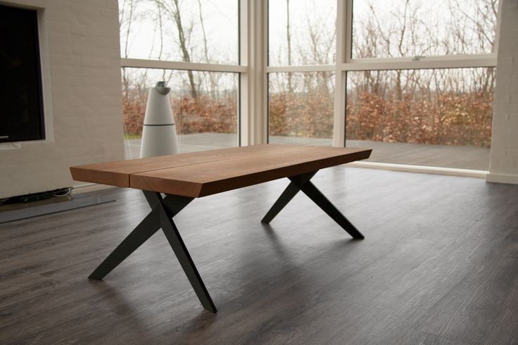 A coffee table made of oak planks and Bruun & Buus designed table legs.