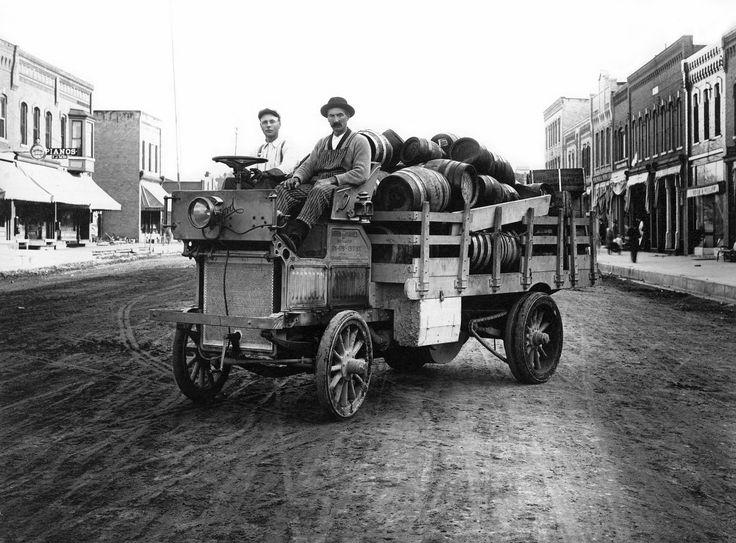 Marshfield Wisconsin beer distributor hauling a load of beer barrels in a hand-crank truck (1910s)