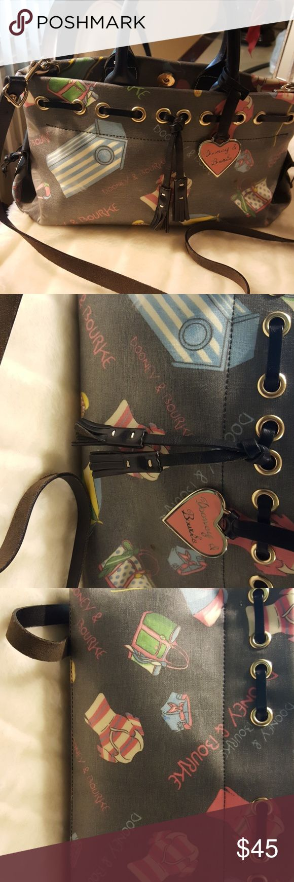 DOONEY AND BURKE CROSS BODY HANDBAG This has has only been used once so in EXCELLENT CONDITION  it a medium sized bag Dooney & Bourke Bags Crossbody Bags