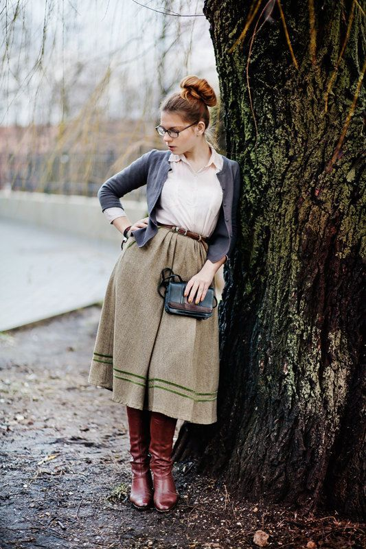 Shop this look on Lookastic:  https://lookastic.com/women/looks/cardigan-dress-shirt-full-skirt/8380  — Burgundy Leather Knee High Boots  — Olive Full Skirt  — Navy Leather Crossbody Bag  — Dark Brown Leather Belt  — White Dress Shirt  — Grey Cardigan
