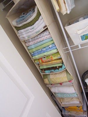 This blogger used this for storage of baby blankets but I'm thinking it would be perfect for fabric storage. AND I already have one that we don't use.