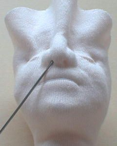 Sculpting a cloth doll face