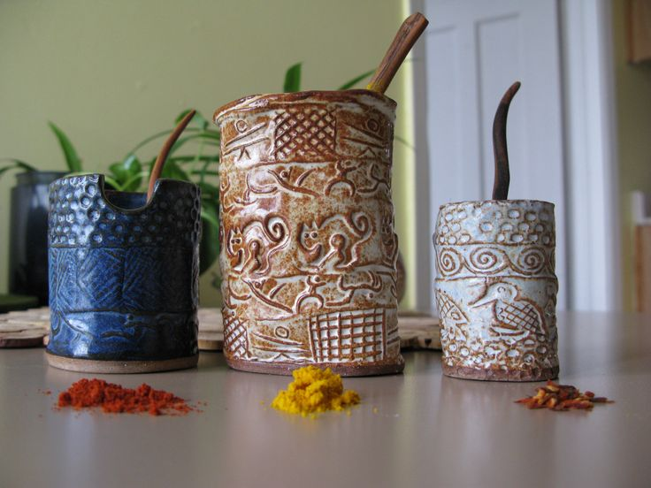 SOLD! Spice cylinders and wooden spoons.
