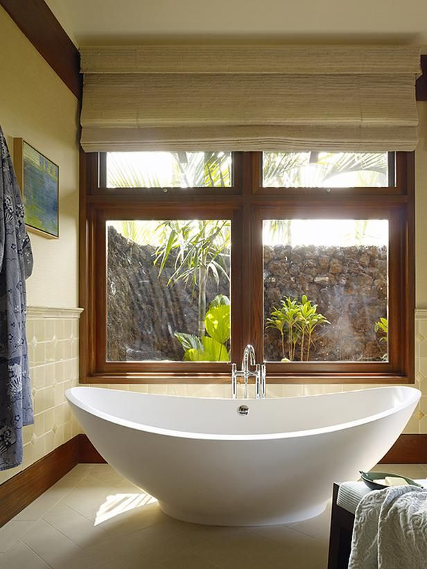 A Secret Garden To get maximum natural light without compromising bathroom privacy, this bathroom features a walled garden outside the picture windows. A contemporary soaking tub provides a spot enjoy the view, undisturbed. Design by Slifer Designs