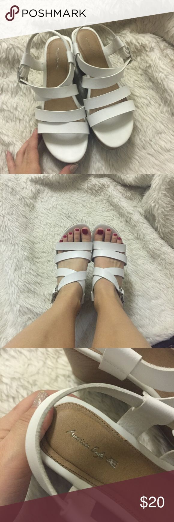 """AE white Wedge sandals Perfect little strapped wedged sandals. Can't feel the height but looks 3"""" taller. It's got some platform so it's easy to walk in. Size 4 in kids fits size 6 women. American Eagle Outfitters Shoes Sandals"""