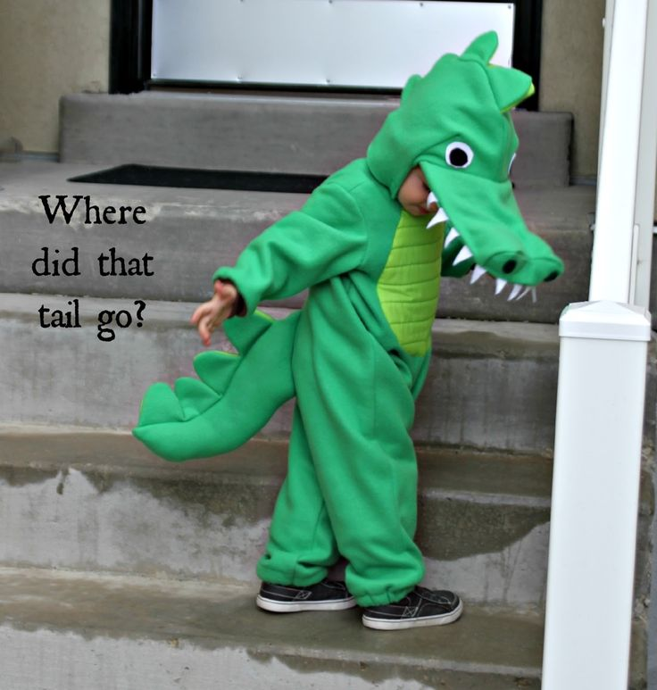 To go with the Princess Tiana theme for Halloween, I made an alligator costume for my 2-year old son. It is perfect for his personality....