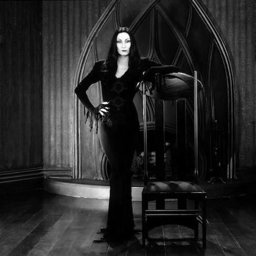 Anjelica Huston as Morticia Addams.