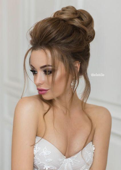 Featured Hairstyle: Elstile; Loose high bun wedding hairstyle idea.