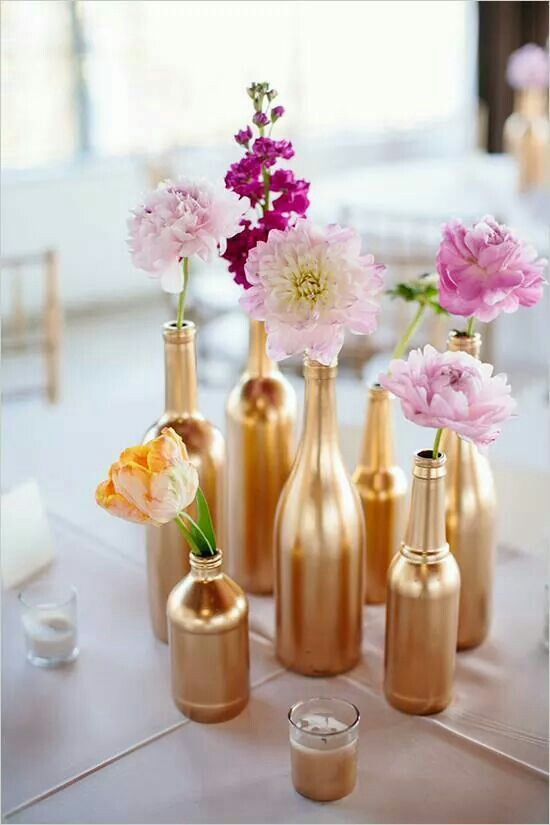 Gold flower vases. Great for any holiday, like New Year's Eve.