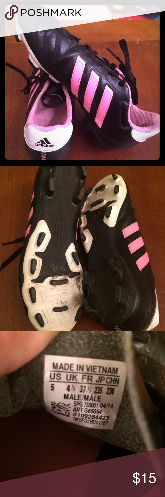 Adidas Soccer Cleats - Black w/ pink stripes Adidas girls soccer cleats Black with pink stripes and pink interiors. The cleat parts are in very good condition. Gently used In great used condition, very little wear.  Size 5 in men's  Perfect for a little one learning to play soccer adidas Shoes