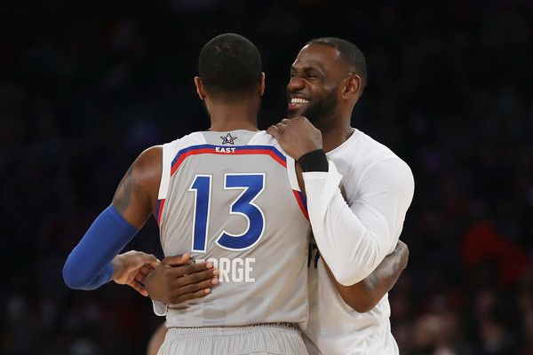 LeBron James Photos Photos - Paul George #13 of the Indiana Pacers hugs LeBron James #23 of the Cleveland Cavaliers during the 2017 NBA All-Star Game at Smoothie King Center on February 19, 2017 in New Orleans, Louisiana. NOTE TO USER: User expressly acknowledges and agrees that, by downloading and/or using this photograph, user is consenting to the terms and conditions of the Getty Images License Agreement. - NBA All-Star Game 2017