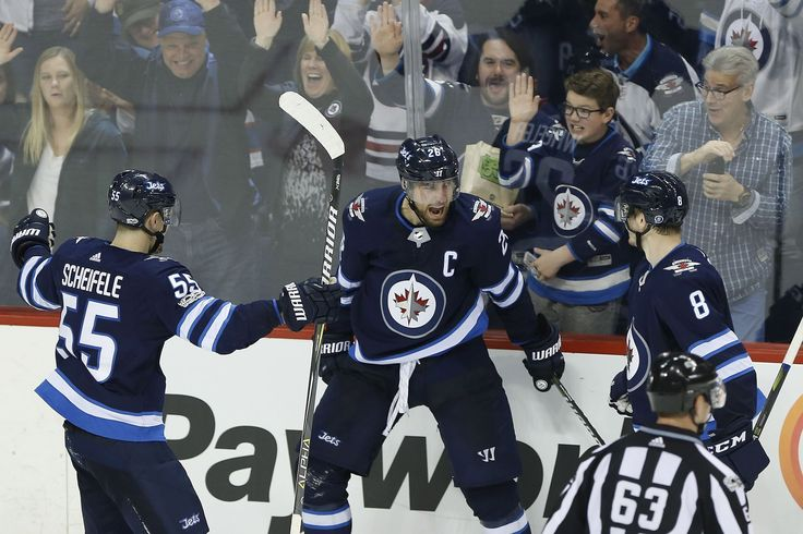 Wheeler's 200th the deciding goal in Jets victory over Wild.Winnipeg Jets' Mark Scheifele (55), Blake Wheeler (26) and Jacob Trouba (8) celebrate Wheeler's game winning goal against the Minnesota Wild during third period NHL action in Winnipeg on Friday, October 20, 2017. THE CANADIAN PRESS/John Woods