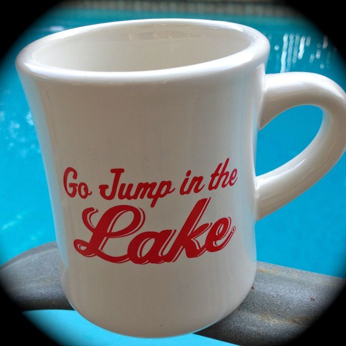 A must have for coffee on the dock. This old school style Cafe Coffee Mug makes a great gift for the lake lover in your life or for yourself! Designed from the vintage cafe coffee mugs used in diners across America in the 1950s and 1960s. Go Jump In The Lake in red. Printed on both sides and approx capacity of 9 oz