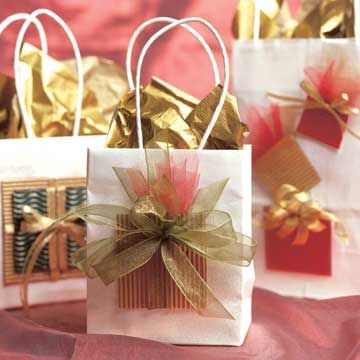 The festive wrapped packages on the outside of these glamorous gift bags promise holiday surprises inside./