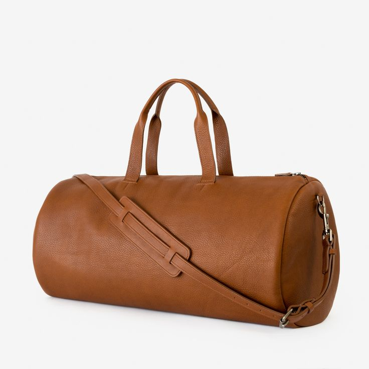 """Inspired by the iconic duffel, AKA """"the seabag"""", we love its versatile roots in military, surfing, and as a hold-all. The cylinder profile provides a minimal look with a generous capacity for travelin"""