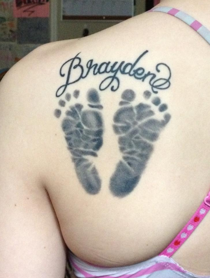 A healed picture of my sons footprints tattoo