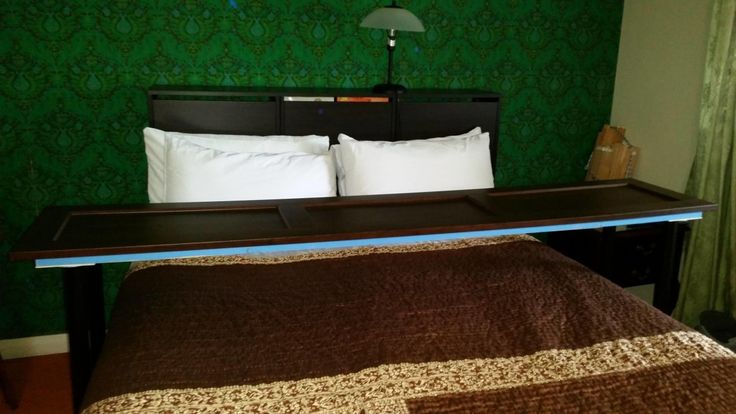 Simple overbed table that extends the width of the bed. Suitable for placing laptops to use in bed, breakfast in bed, or clothing stash.