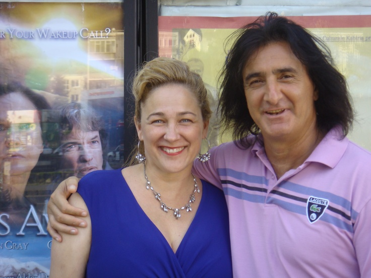 Susan Johnston and Nikola in front of Dreams Awake poster