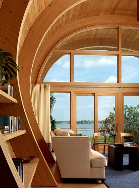 """Designed by Totems Inc to mimic canoe and ship hulls, glue-laminated pine beams bring wooden warmth to the inside (and reference surrounding oaks) while allowing curves that would be impossible with traditional lumber.""  Fabulous!"