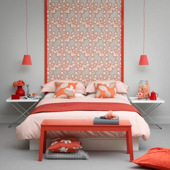 Master bedroom in coral pink with paper wall hanging
