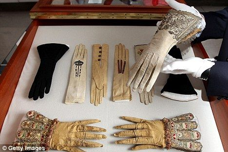 An ornate glove, worn at the monarch's Westminster Abbey coronation on January 15 1559, it is just one of a number of gloves belonging to past kings and queens being exhibited at Selfridges' London flagship. Queen Elizabeth I's coronation gauntlet glove was hand-sewn from white alum-tawed suede leather, has a cuff decorated with silver thread, pearls and sequins and features silk satin inserts in a stylised design showing an orb, flowers and leaves.