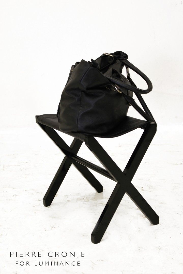 A custom Pierre Cronje purse stool for the Luminance shoppers - purses and bags need never touch the floor again!