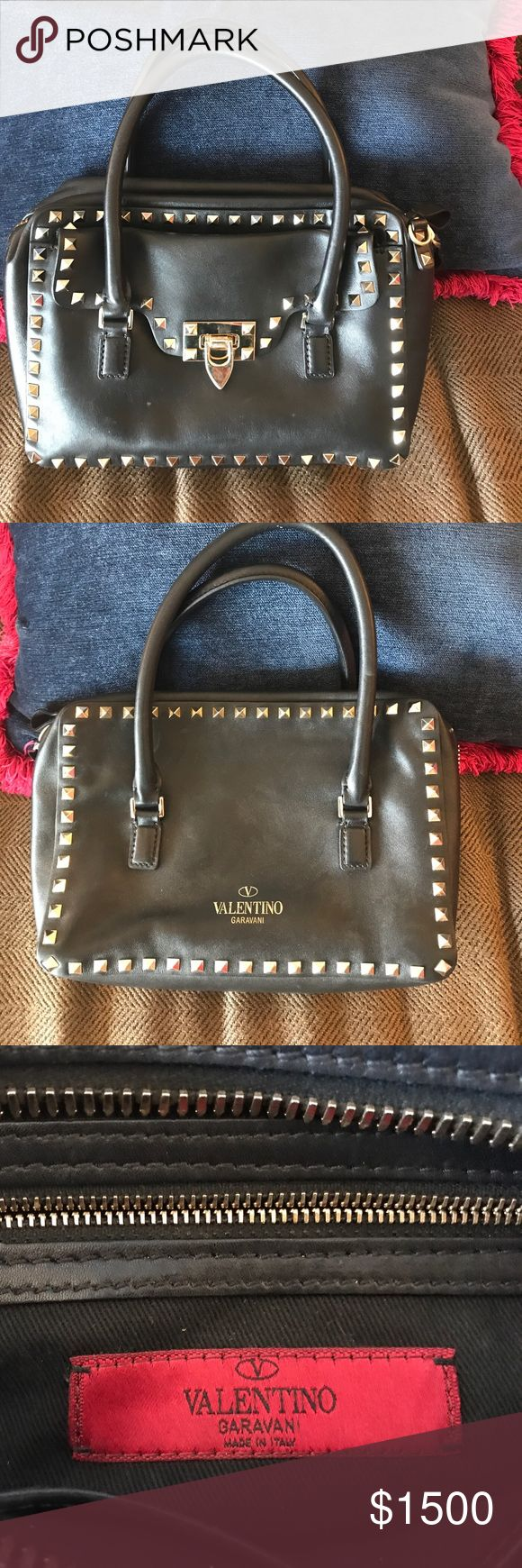 "AUTHENTIC VALENTINO HANDBAG BEAUTIFUL VALENTINO Handbag! Medium sized bag with lots of zipper storage! Can be used as a ""tote"" or a shoulder bag. The bag is missing a stud (pictured above). Simple fix in order to use the strap. Originally purchased for $2675 from Neiman Marcus. Valentino Bags Shoulder Bags"