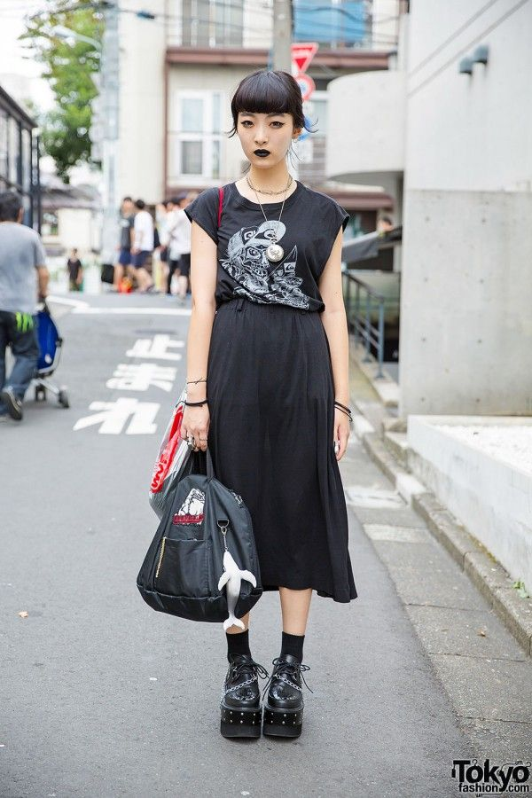 This is Chikio, a striking girl we met in Harajuku, when she was wearing all black (including lipstick). She is 17 years old and she's a student.