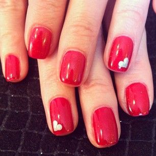 If nail art intimidates you, you can always opt for a coat of classic red. As for that tiny heart, you could even try drawing it in with a metallic calligraphy pen after your nails dry. | 26 Ridiculously Sweet Valentine's Day Nail Art Designs