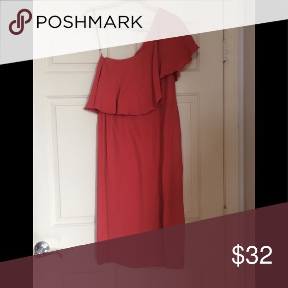 """Topshop Dress For sale is a coral Topshop dress. It is one shoulder, and features the ruffle all the way around the dress. There is also a slit in the front on the left side, approx 18"""" in length. The dress itself is a longer, midi length. There is a small place at the end of the zipper that needs a stitch or two, that was there when I bought the dress, and I never got it repaired. Worn twice. Topshop Dresses One Shoulder"""