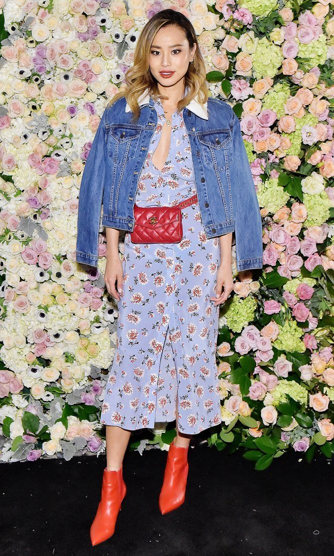 9950cf8fc457 Jamie Chung in a Veronica Beard floral dress and denim jacket with Chanel  red belt bag and red boots