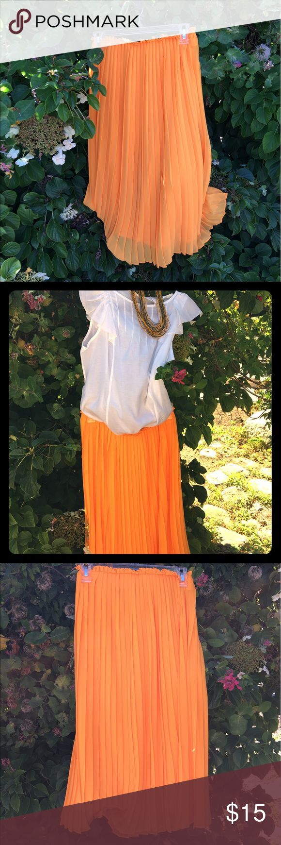 🍊Flirty mandarin orange Zara skirt🍊nwot Flowy and flirty, this elastic waist skirt will give your summer wardrobe a fun pop of color. Looks lovely with navy, black and bright pink. Calf length and fully lined Zara Skirts Midi