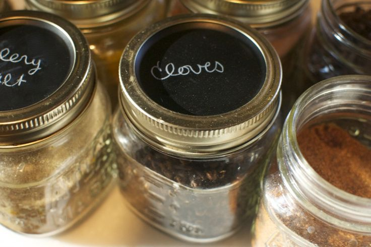 Pantry organization tip and a way to reuse old canning jar lids - spray with chalkboard paint.