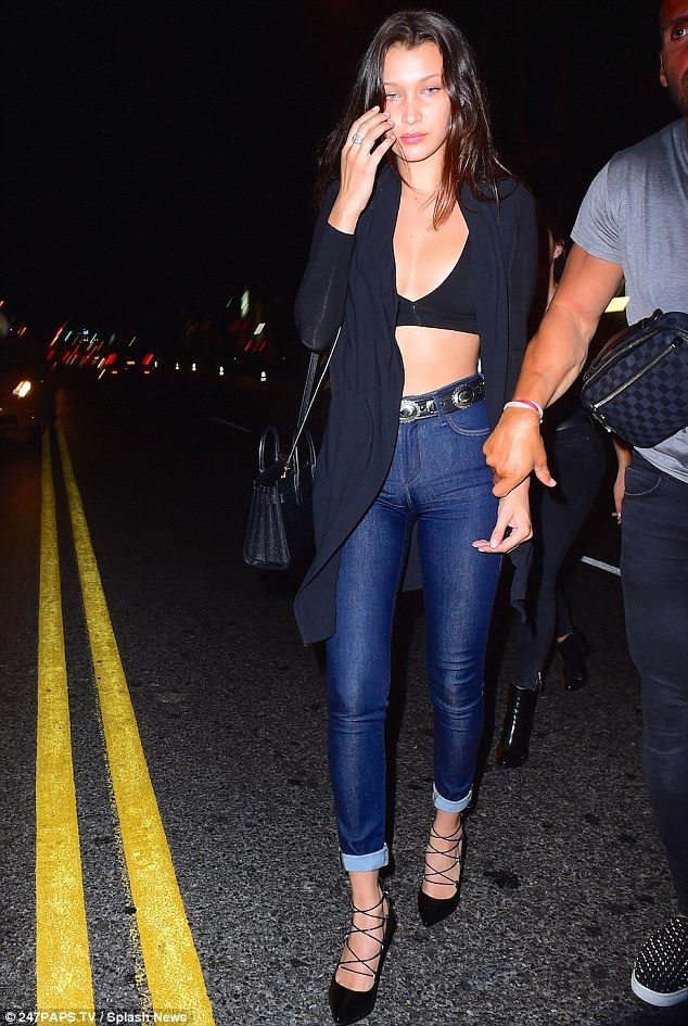 Bella Hadid.. Blue Life Crop Top, THE LAIR Belt, Saint Laurent Bag, and Saint Laurent Paris Pumps..