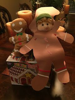 Cutesy dressed up like a gingerbread man and brought the gingerbread house.
